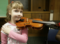A student holding a viola in playing position