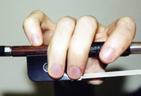 Proper violin / viola bow hand position, showing contact points of the fingers.