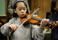 A student playing a violin