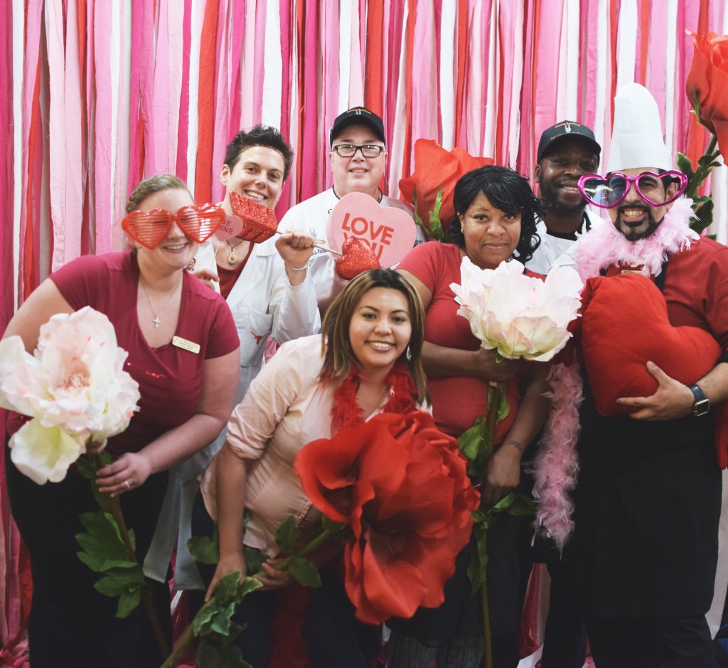 Amy Ballentine, Laura Mangini, Lauren Pelchat, Sherry Flint, Ivory Mobely, Thelma Robledo and Michael Colom in the Valentine Dinner photo booth