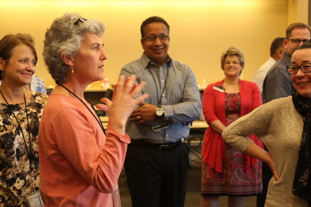 The University Health Services management team asks questions about leadership during their dance lesson.