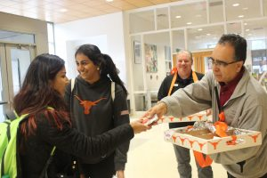 Behzad Salsabilian hands out tacos to students in the Student Activity Center.