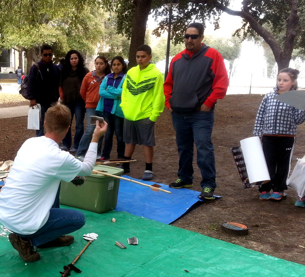 Chris shows everyone what the raw materials used were, demonstrating with a  piece of chert.
