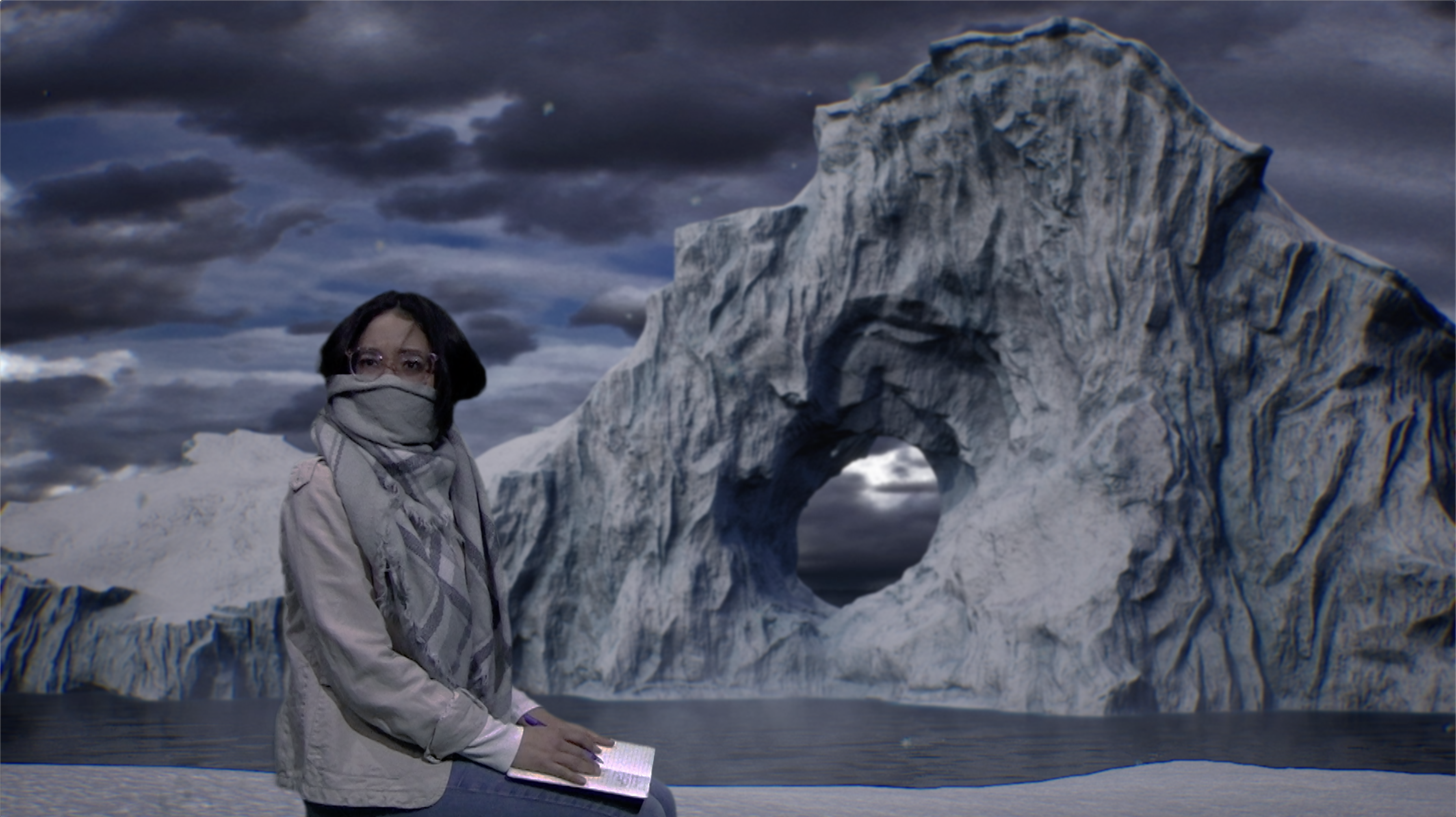 woman sitting in front of an iceberg