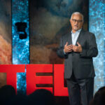 Dean Zayas delivering a TEDTalk
