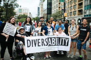 Group of people posing with banner that says Diversability