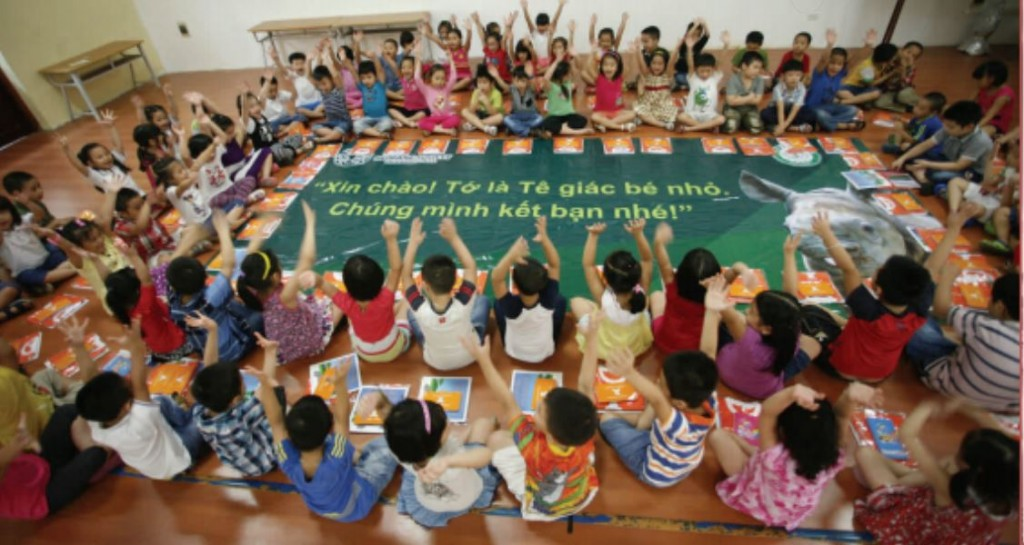 """""""Hello! I'm a little rhino. Let's be friends!"""" School-aged Vietnamese children participating in the Humane Society International and Cites campaign to reduce rhino horn demand."""